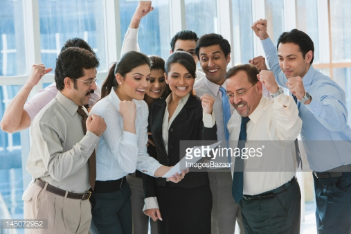 145072952-business-people-reading-document-and-gettyimages