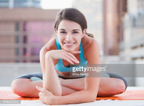 458222005-caucasian-woman-smiling-on-urban-rooftop-gettyimages