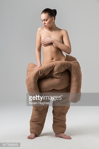 547566649-woman-pulling-off-fat-suit-gettyimages