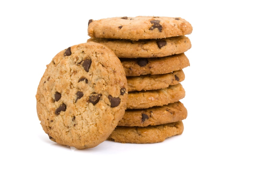 Pile of chocolate chip cookies isolated on white background